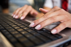 Woman typing on laptop, selective focus, canon 1Ds mark III