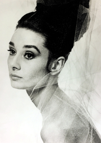 """Stage and Screen, Personalities, pic: 1957, Actress Audrey Hepburn poses for a publicity shot, Audrey Hepburn, (1929-1993) born in Brussels, a truly international star from a cosmopolitan background, starred in many films, eg, """"My Fair Lady"""" and """"Breakfast at Tiffany's"""" (Photo by Popperfoto/Getty Images)"""