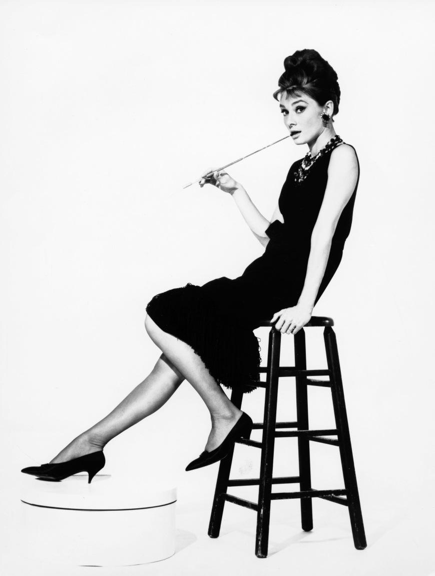 Audrey Hepburn, actress. Portrait on a bar stool. film still Breakfast at Tiffan
